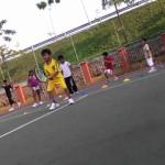 Tennis coach Hafizi teaching kids forehand
