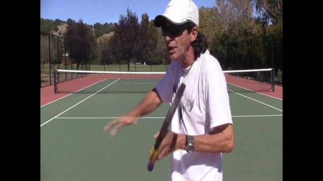 """Why Roger Federer's Slice Backhand Has A """"Cut Down"""" Follow-Through"""